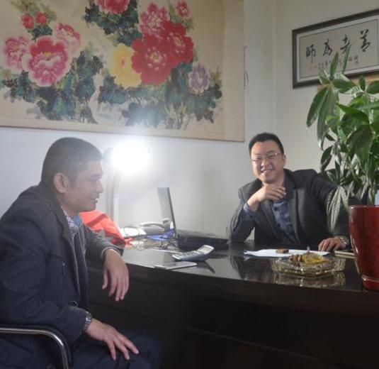 陈大果老师与推广客户黎总合影